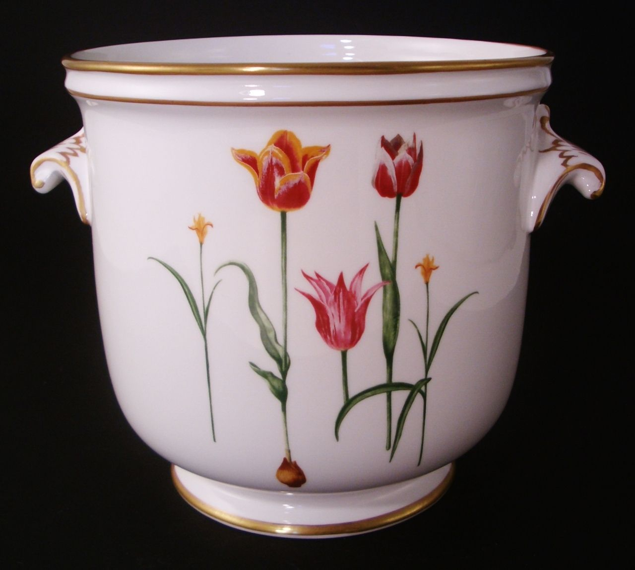 Tulip cachepot. These cachepots come in a wide variety of lovely image designs. They match their dinnerware patterns, too.