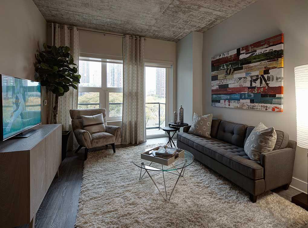 Elegant living room of our model apartment at AMLI Lofts ...