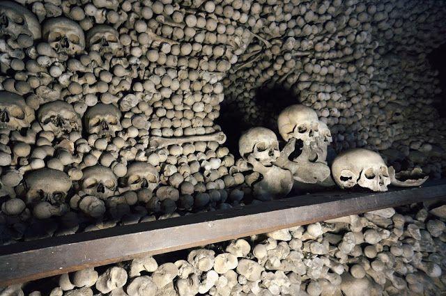 creepy catacombs with skulls in prague