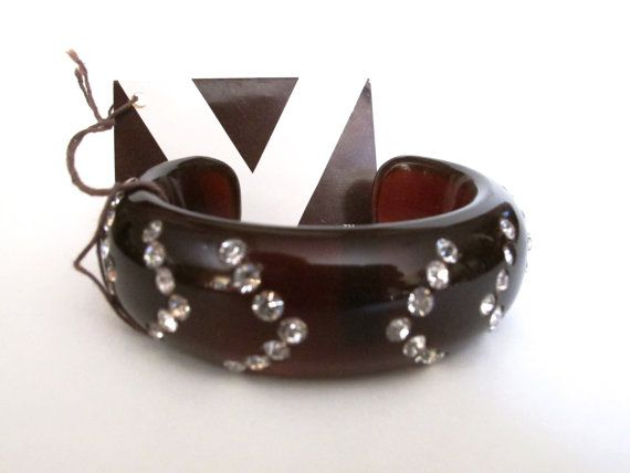 two of them Plastic brown and red cuff bracelets