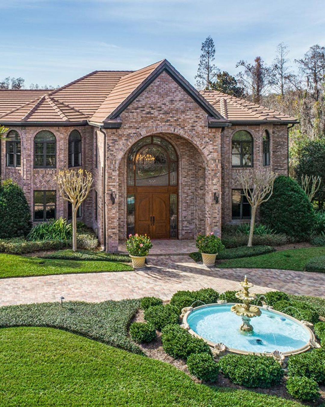 Impressive twostory traditional brick home // Listed by