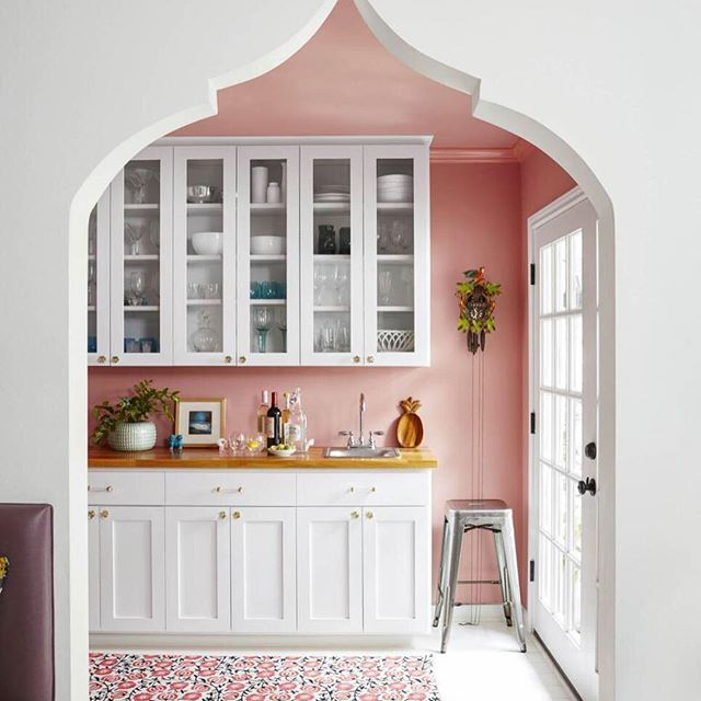 Pretty pink paint and a Moroccan-inspired door make this pantry from #HGTVMagazine feel special. Click the #linkinbio to see the rest of the space!