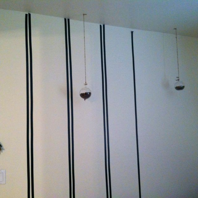 Can't permanently alter your walls? Use electric tape to give the illusion of paint or wallpaper.
