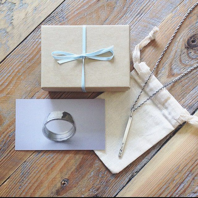 Current packaging, love the linen pouch color and texture.  Love the business card gray/blue coordinating with the blue ribbon around the box.  Love how both tones tie in with this wood grain that I use on Insta photos so much.