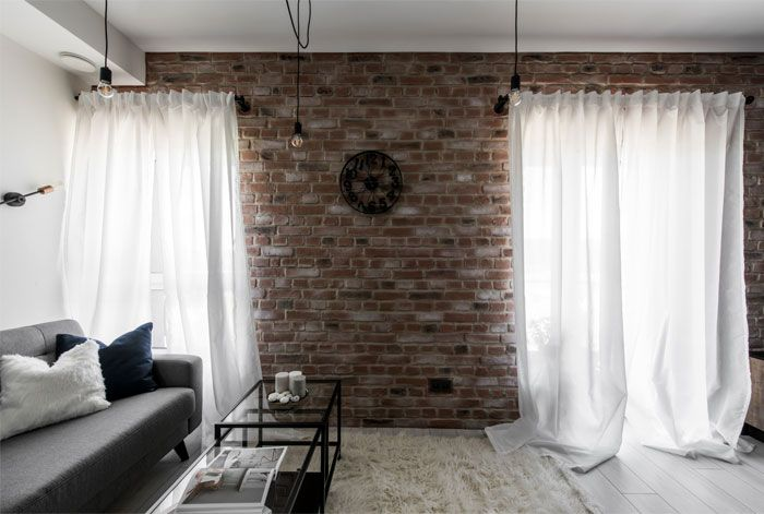 An Industrial Inspired Apartment With Exposed Brick Metal And Concrete Living Room Design Modern Interior Design Colleges Modern Apartment