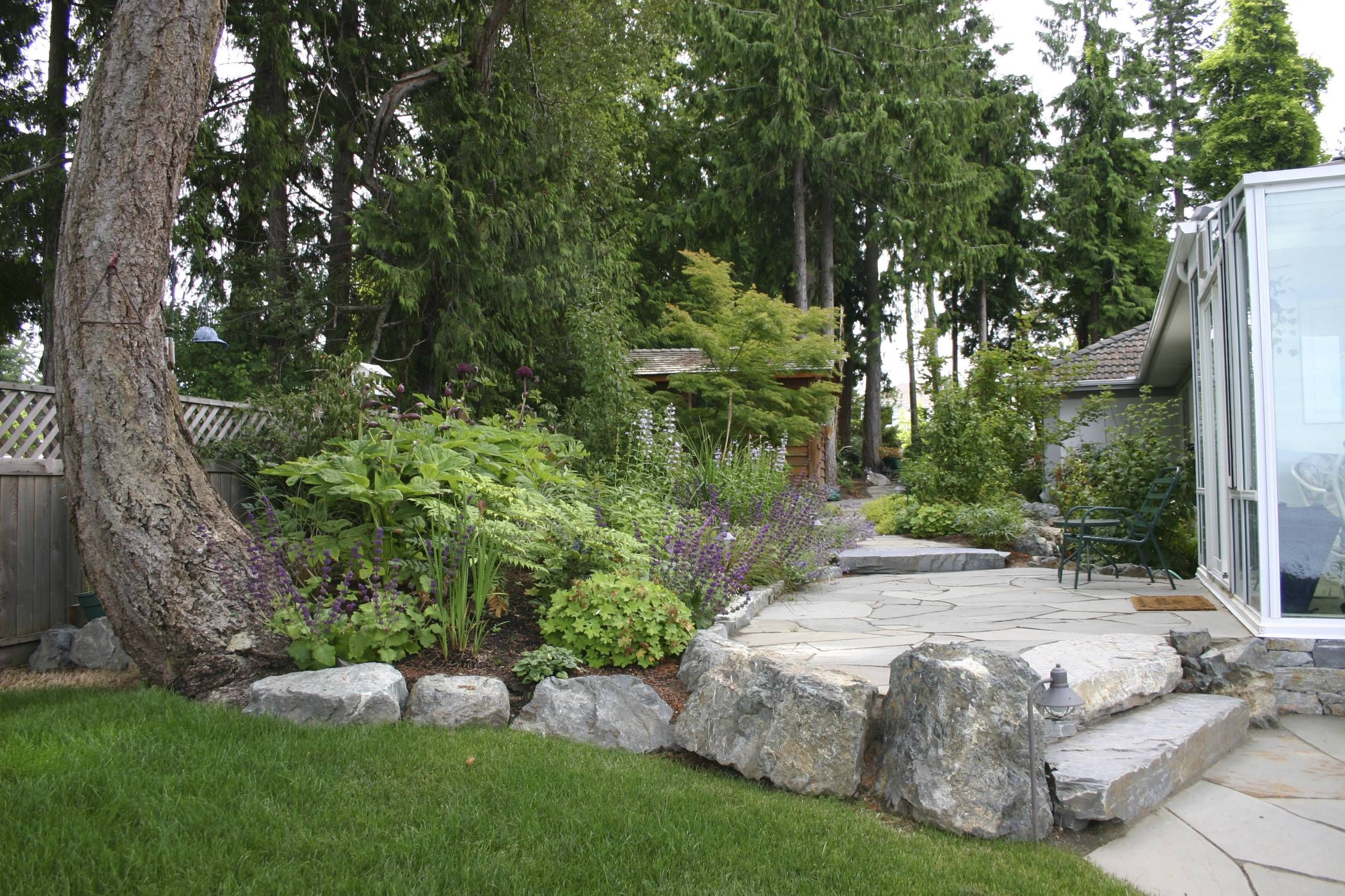 Stone Slab Stairs, Patio, Stone Landscape Edging, Sunroom And Plantings