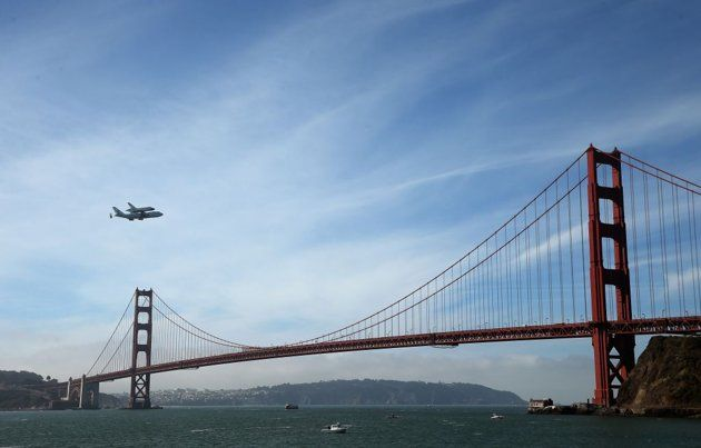 Golden Gate Bridge, San Francisco, USA:  The space shuttle Endeavour, on top of NASA's Shuttle Carrier Aircraft or SCA, makes a pass over the Golden Gate Bridge before making its final landing in Los Angeles in San Francisco, California.  Photo By Ezra Shaw/Getty Images