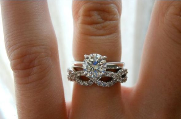 Yep, I definitely want an infinity wedding band and just a solitaire round wedding ring... maybe a tighter twist on the infinity band. AHH SO GORGEOUS!
