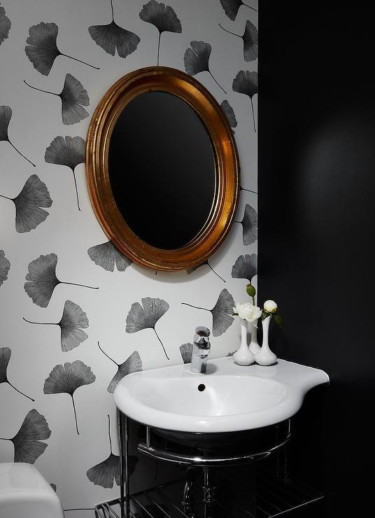 A Gold Leaf Oval Mirror Is Mounted To Ginkgo Marimekko