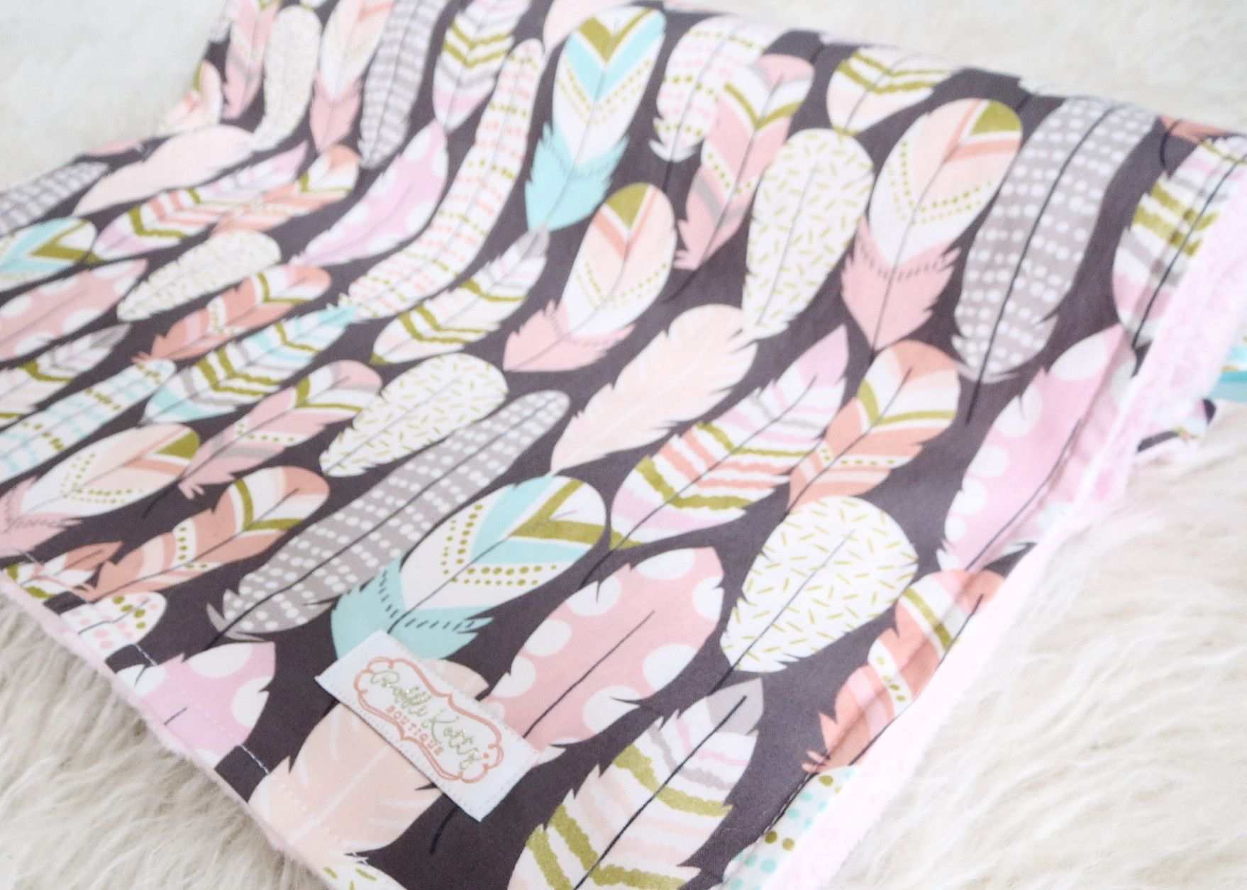 Baby girl is sure to snuggle with this feather baby blanket for years to come. Super stylish and modern pink minky blanket with feathers is a great addition to the nursery. This minky blanket is super