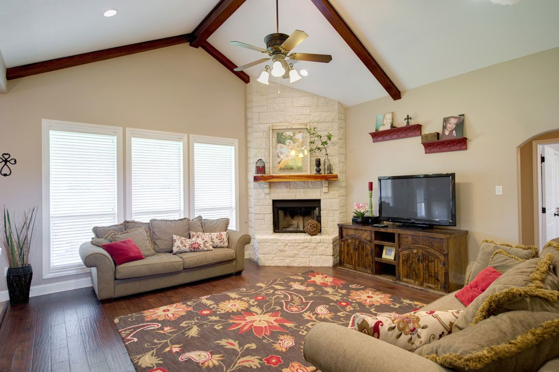 The Corner Fireplace Vaulted Ceiling Recessed Lighting And Hand Scraped Wood Floors Combine To