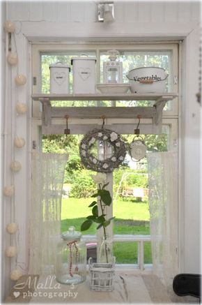 Shabby Chic...just darling with all the vintage tins and little shabby wreath...wonderful detail.