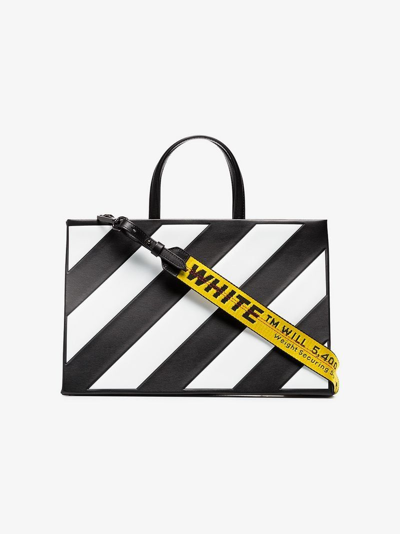 bc753f931 OFF-WHITE | Striped Medium Leather Tote Bag | $1,590 | This black and white  Off-White striped medium leather tote bag showcases a box bag design with  ...