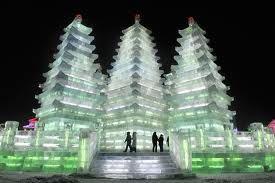 People visit tall ice pagodas