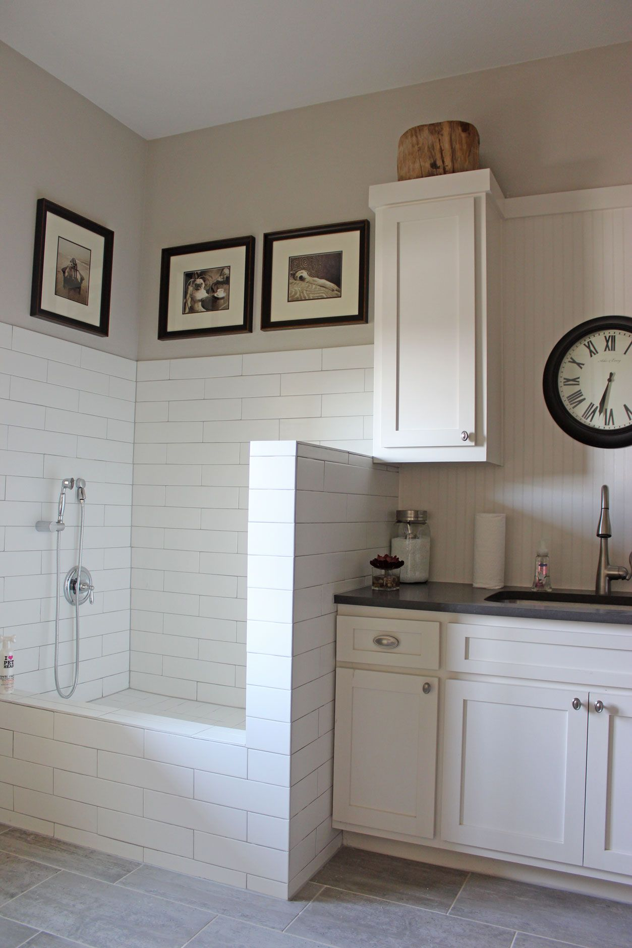 Burrows Cabinets white painted laundry room cabinets with tiled dog