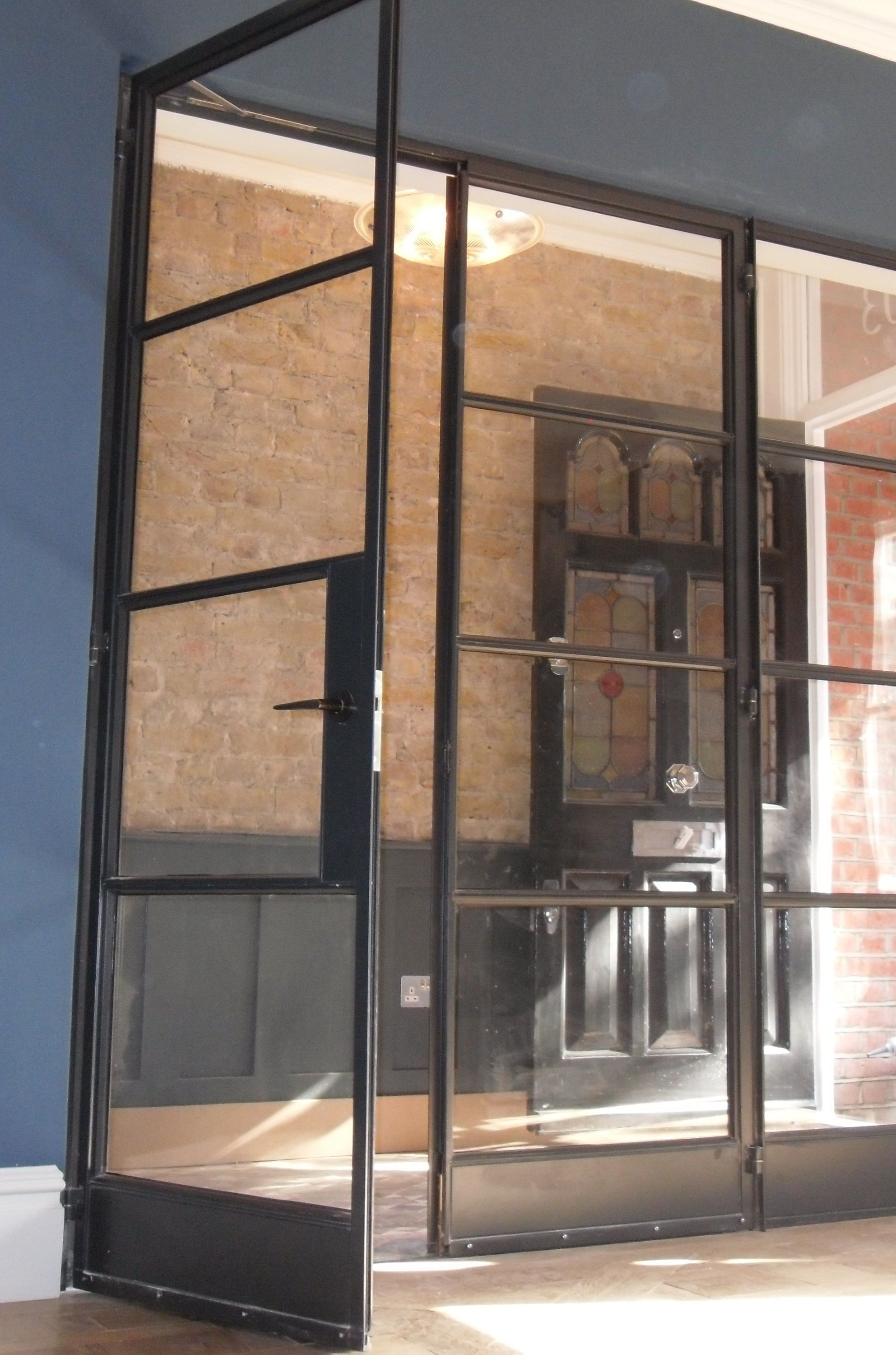 Crittall door screen by Lightfoot Windows (Kent) Ltd separating the grand entrance hall from & Crittall door screen by Lightfoot Windows (Kent) Ltd separating the ...