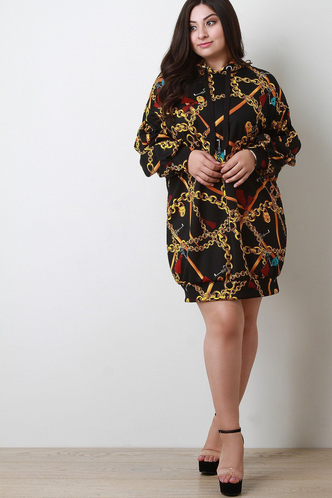 dc69bce623b This plus size dress features a smooth stretchy knit with chains print