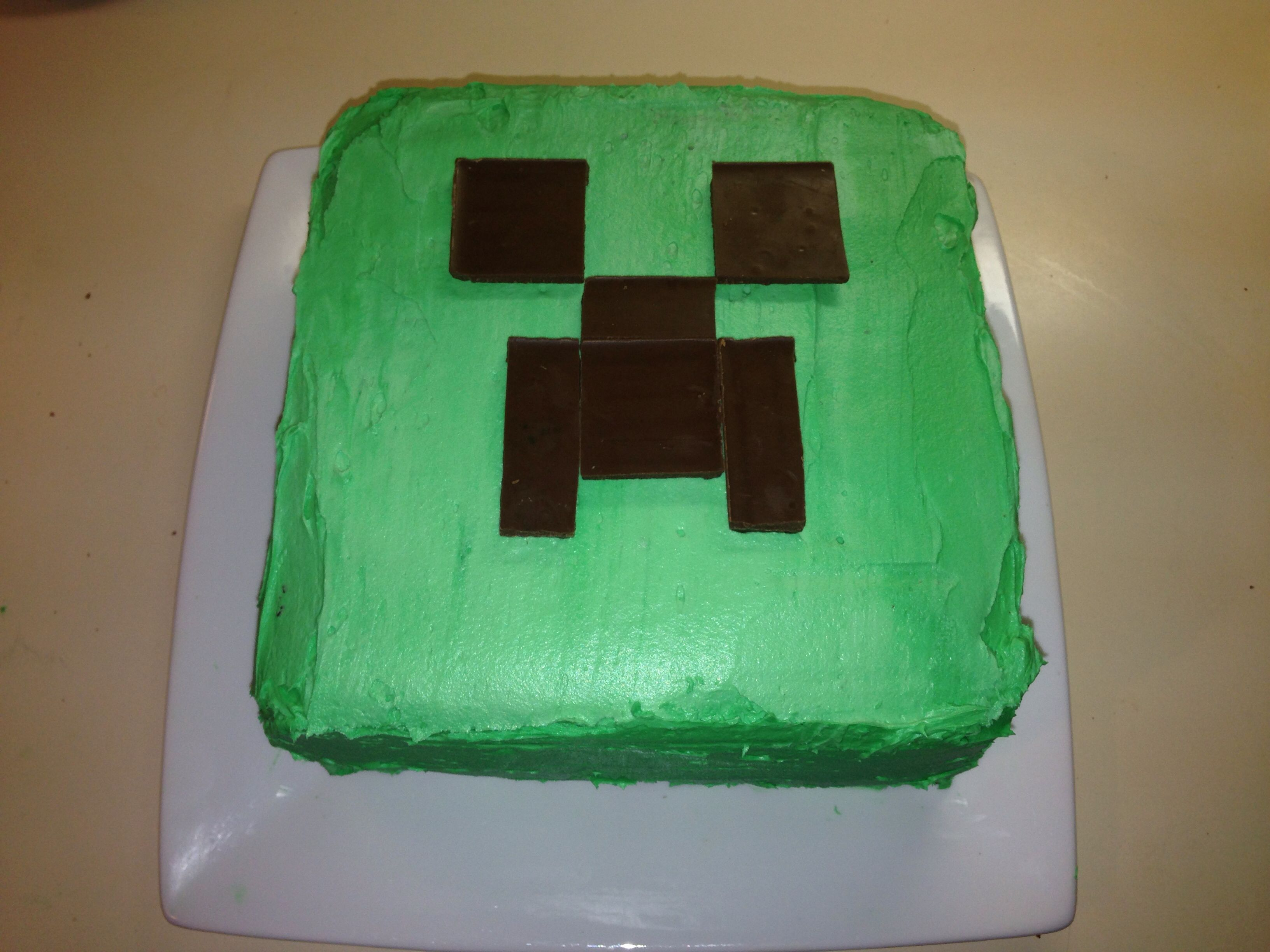 Here S The Minecraft Creeper Cake I Made For My Son S Birthday Hershey S Bars Were Used For The Face A Parsons Cake Creeper Cake Minecraft Cake