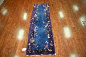 Brilliant blue with purple border. Nichols Deco Chinese rug from the 1920s