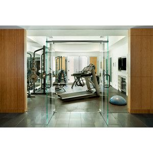 love the glass door entry into this home gym  small home