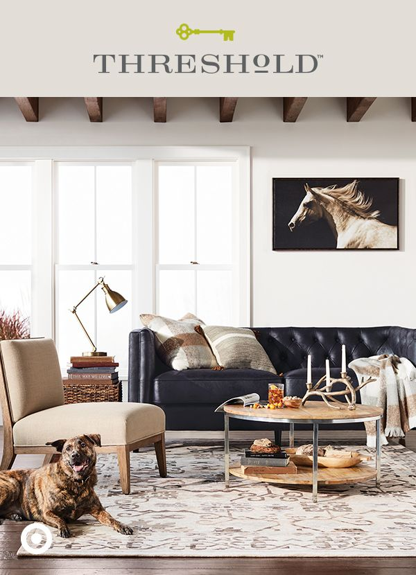 Neutral tones and layered textures like woods and mixed metals set the foundation for a for Mixing metals in living room