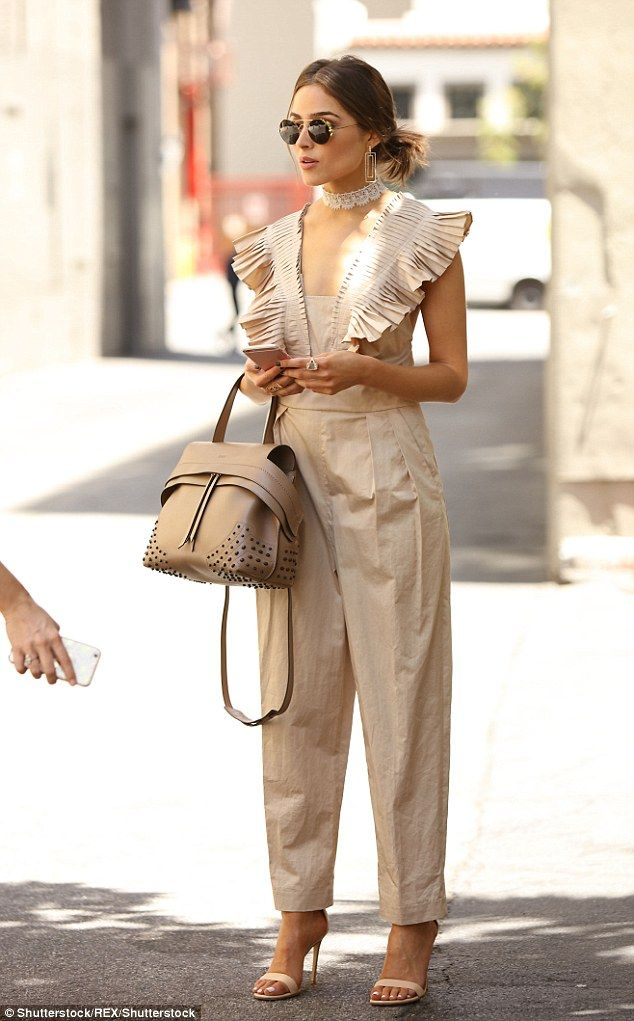 Olivia Culpo looks stylish in pleated jumpsuit and lace choker – Dress to Kill