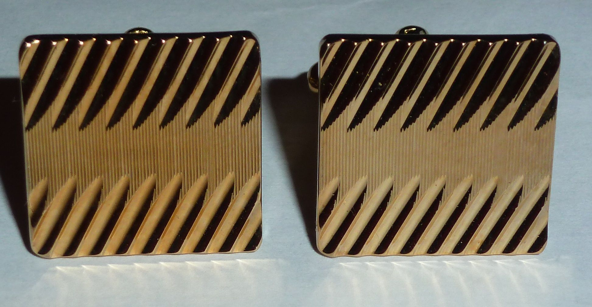 Diagonal diamond cut gold vintage cufflinks stand out from the