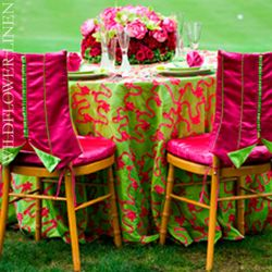 Lime green and hot pink tablecloth with matching centerpiece via Wildflower Linen.
