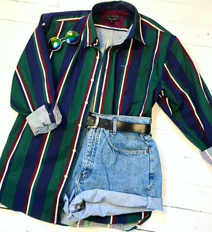 Photo of Green shirt with buttons and denim shorts. Summer fashion