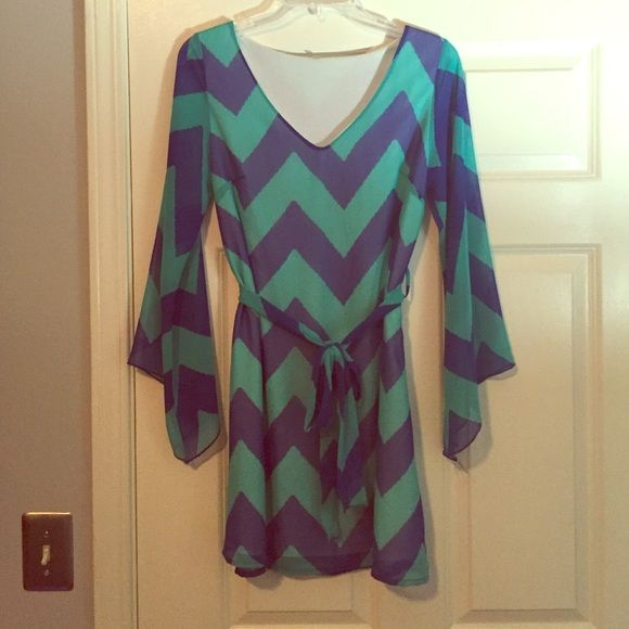 Boutique blue and green chevron dress excellent like new condition! I cut the tag out but I bought it at a local boutique in Memphis TN and it's a size small! Adorable dress!! Dresses