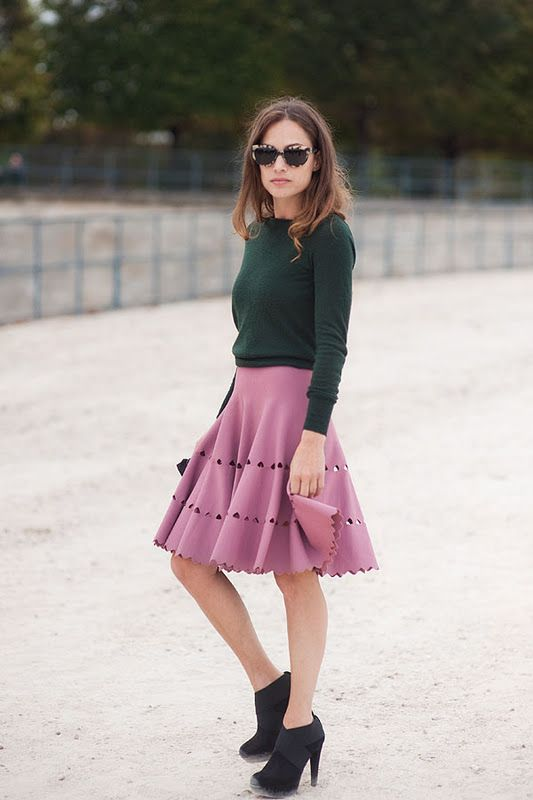 Pretty 50's style swing skirt dressed down with a black sweater and booties, love!