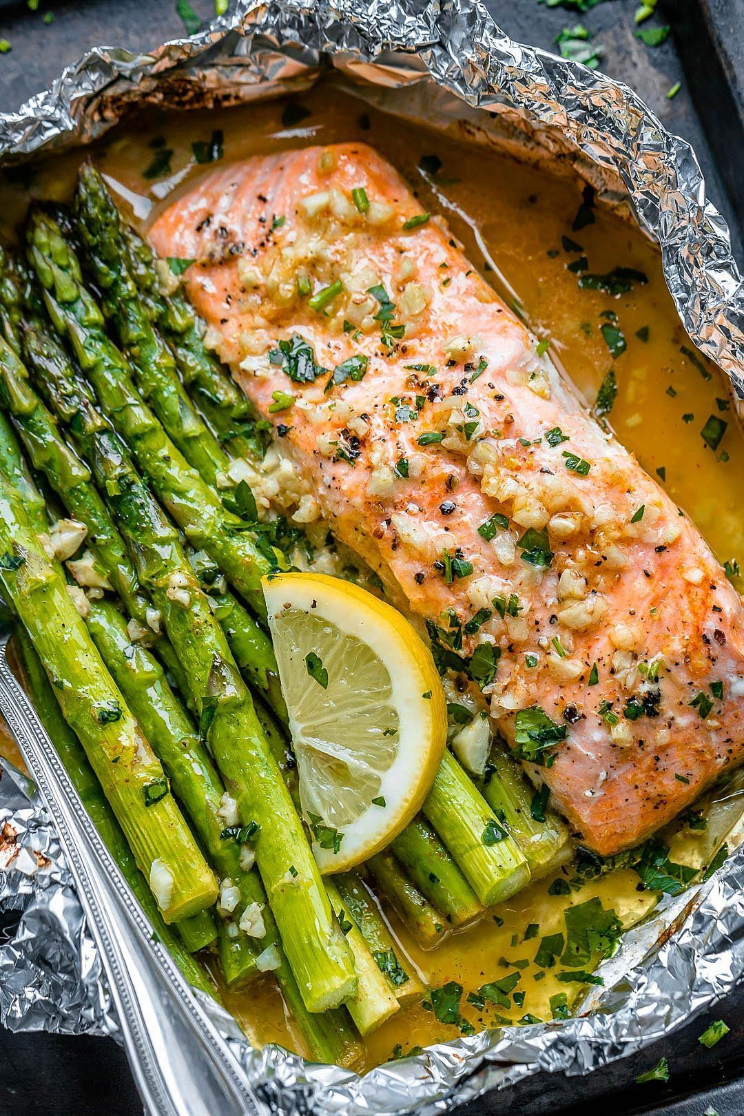 Photo of Salmon and asparagus foil packs with garlic-lemon-butter sauce