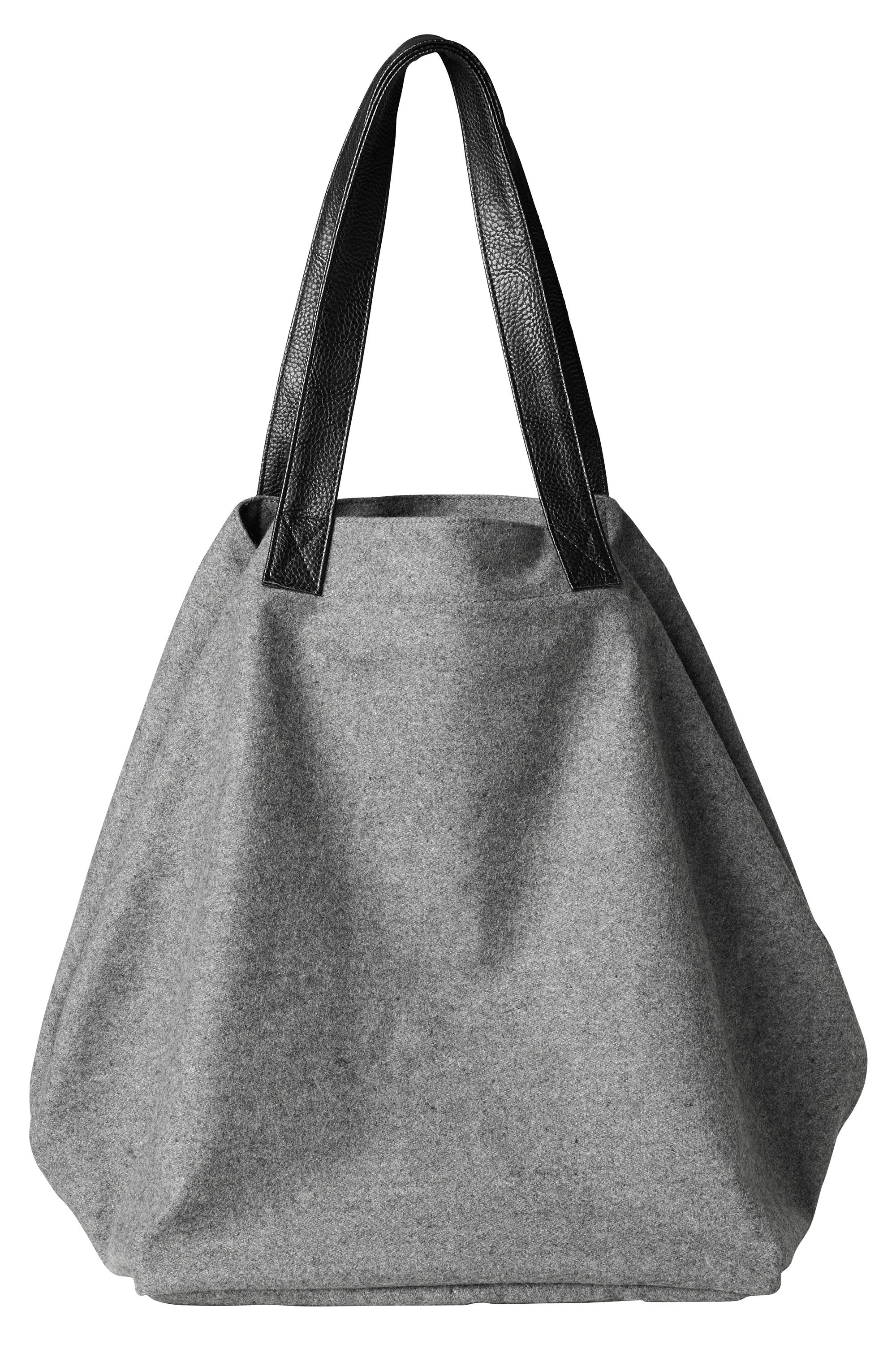 Cool, clean, wooly material with contrast black leatherette handles give this slouchy 'wear it everywhere' bag a winter chic update.