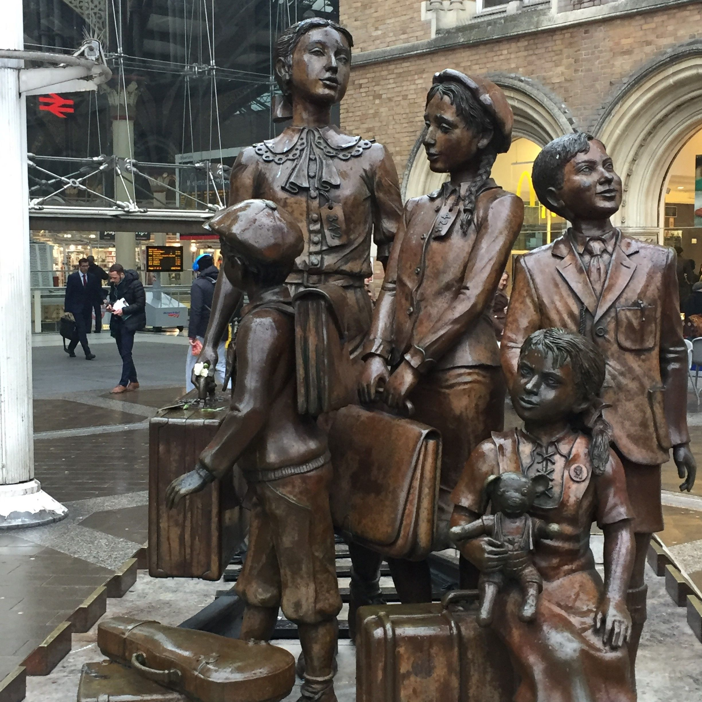 "A statue in front of London's Liverpool Street Station commemorates the Kindertransport. A plaque at the base expresses ""gratitude to the people of Britain for saving the lives of 10,000 unaccompanied mainly Jewish children who fled from Nazi persecution"