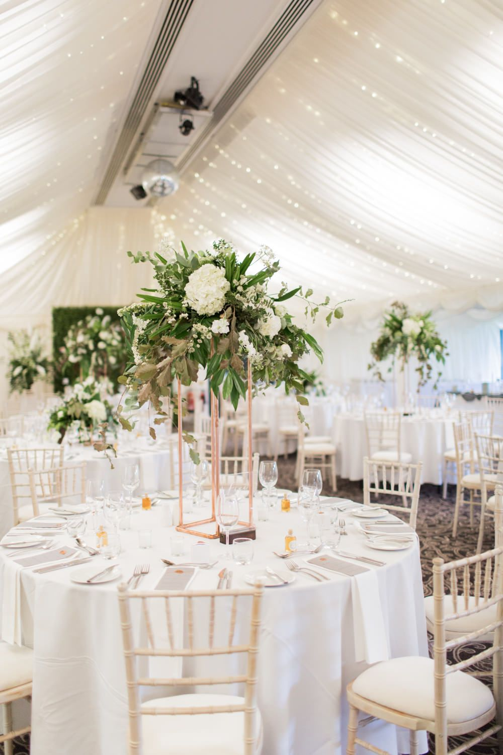 Tall Fl Centrepieces Greenery White Marquee Wedding At The Villa Levens With Copper Details Bowtie And Belle Photography