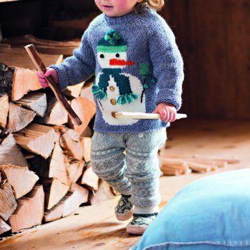 Un pull pour enfant orné d\'un bonhomme de neige / A kid's sweater with a snowman