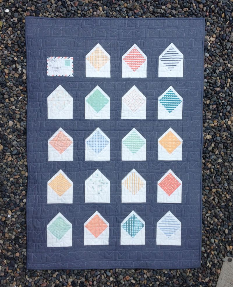 Envelope quilt with solid navy background. One envelope closed ... : envelope quilt pattern - Adamdwight.com