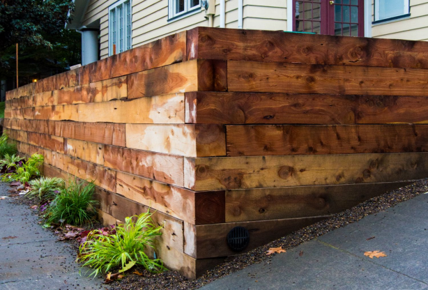 Hefty 6x6 Juniper Landscaping Timbers Were Used For This Beautiful Retaining Wall Chemical In 2020 Wooden Retaining Wall Landscaping Retaining Walls Landscape Timbers