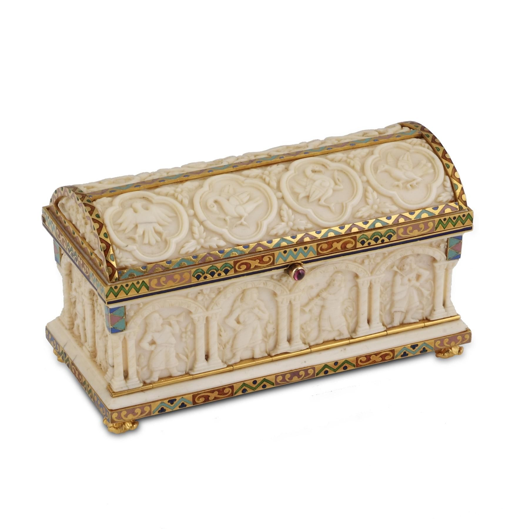 BOUCHERON. AN ENAMEL AND IVORY STAMP BOX. Designed as a stylised sarcophagus, the arched ivory lid carved with eight bird motifs with foliate accents, the ivory base carved with a series of musician and dancing figures each under an arch, embellished with floral accents, the yellow gold base and structural lid settings applied with red-, teal- and blue-coloured champlevé enamel, the ruby push-piece opening to reveal three ivory compartments.  Price:£50,000