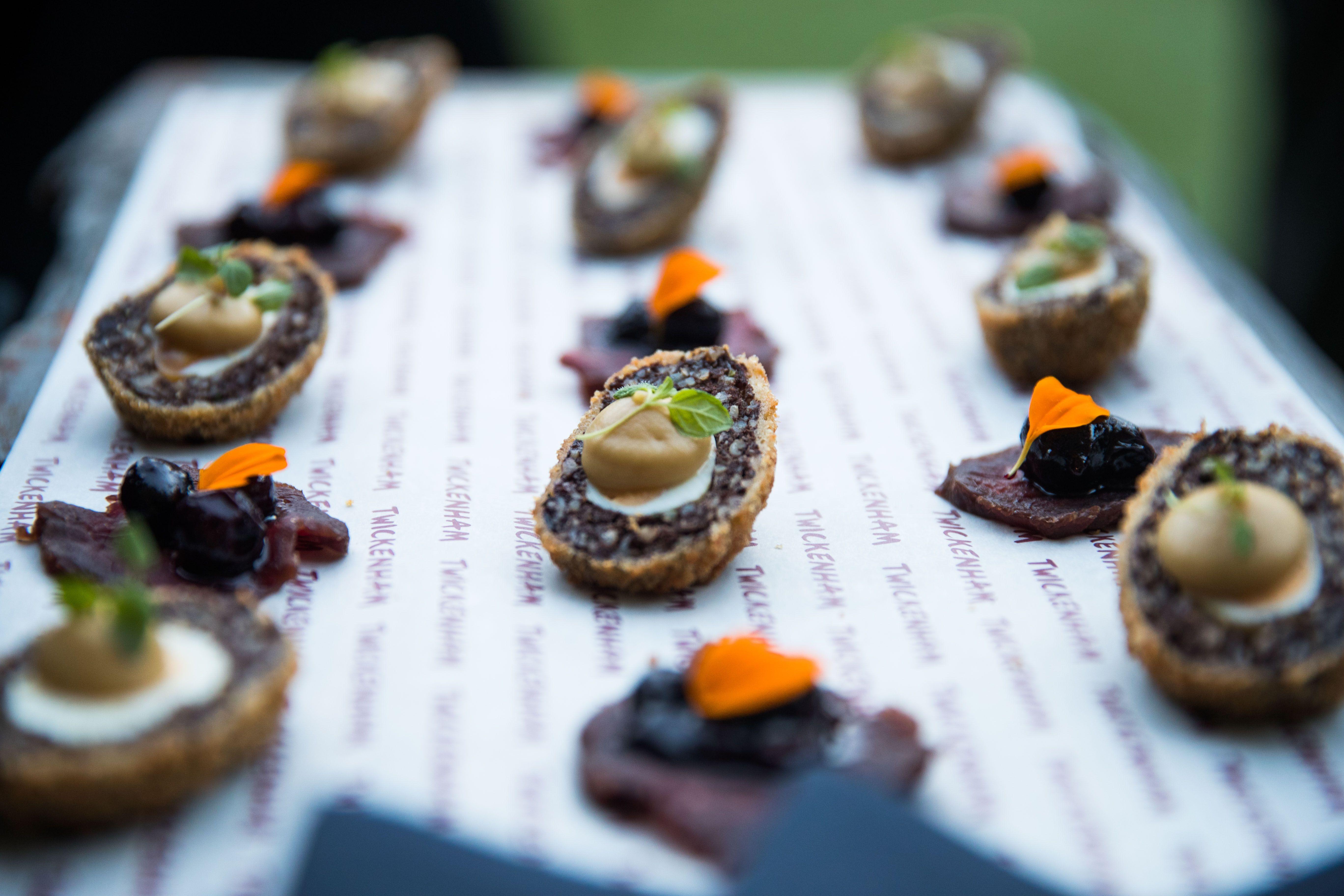 black pudding and quail egg scotch eggs and venison and bilberry canapes sharetwickers