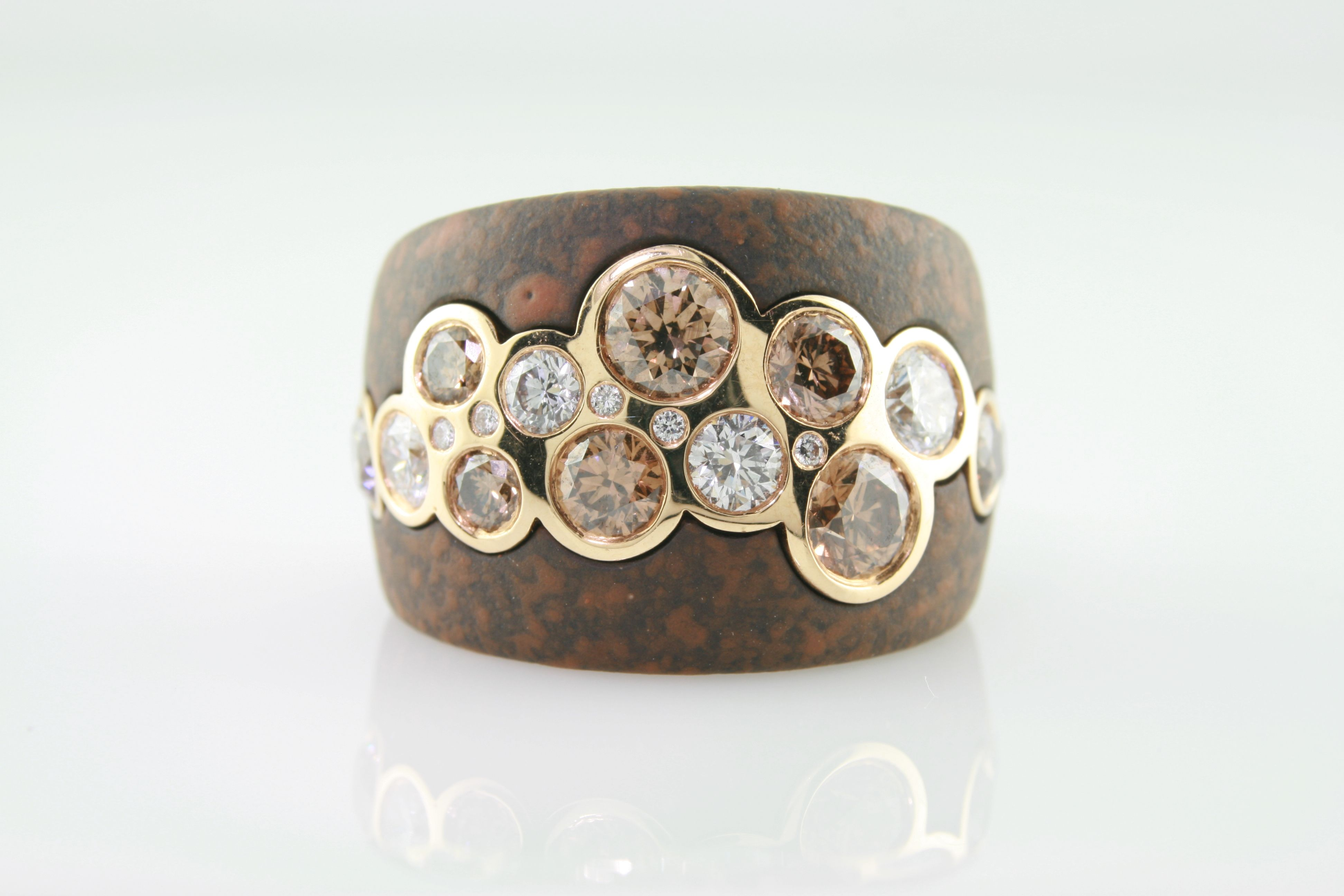 Cognac & colorless diamonds set in 18k rose gold with guards