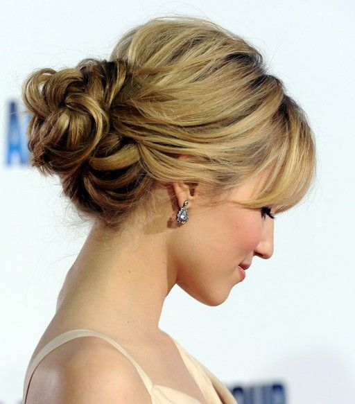 A simple yet stylist bun. The hair is softly pulled back to create soft texture. My fave!