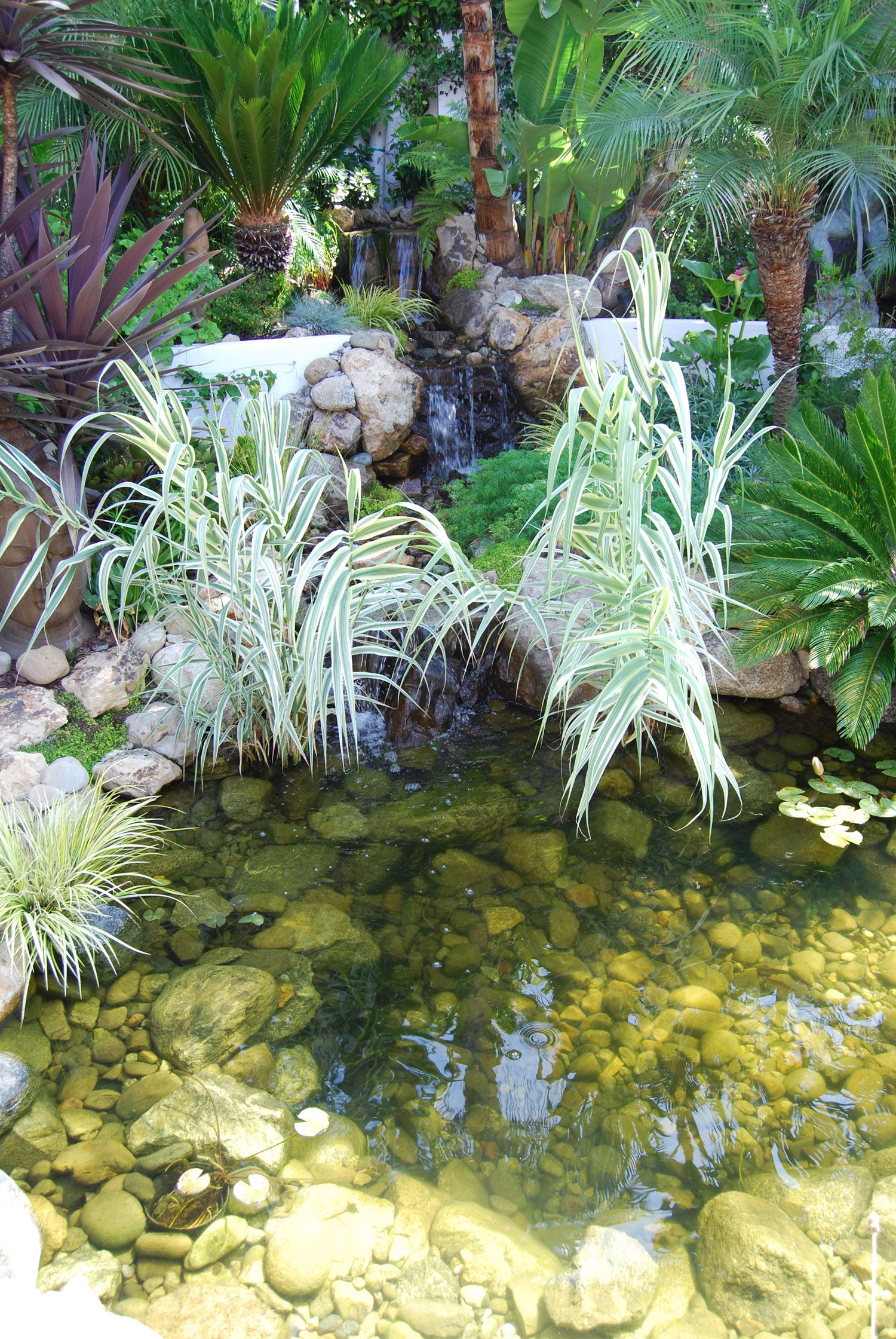 Custom Waterfall And Pond Water Features In The Garden 400 x 300