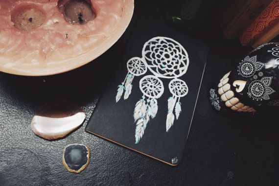 Sit this by your bed and record all your nocturnal adventures. Hand painted dream catcher on ruled Moleskine Journal. 80 pages, last 16 detachable.