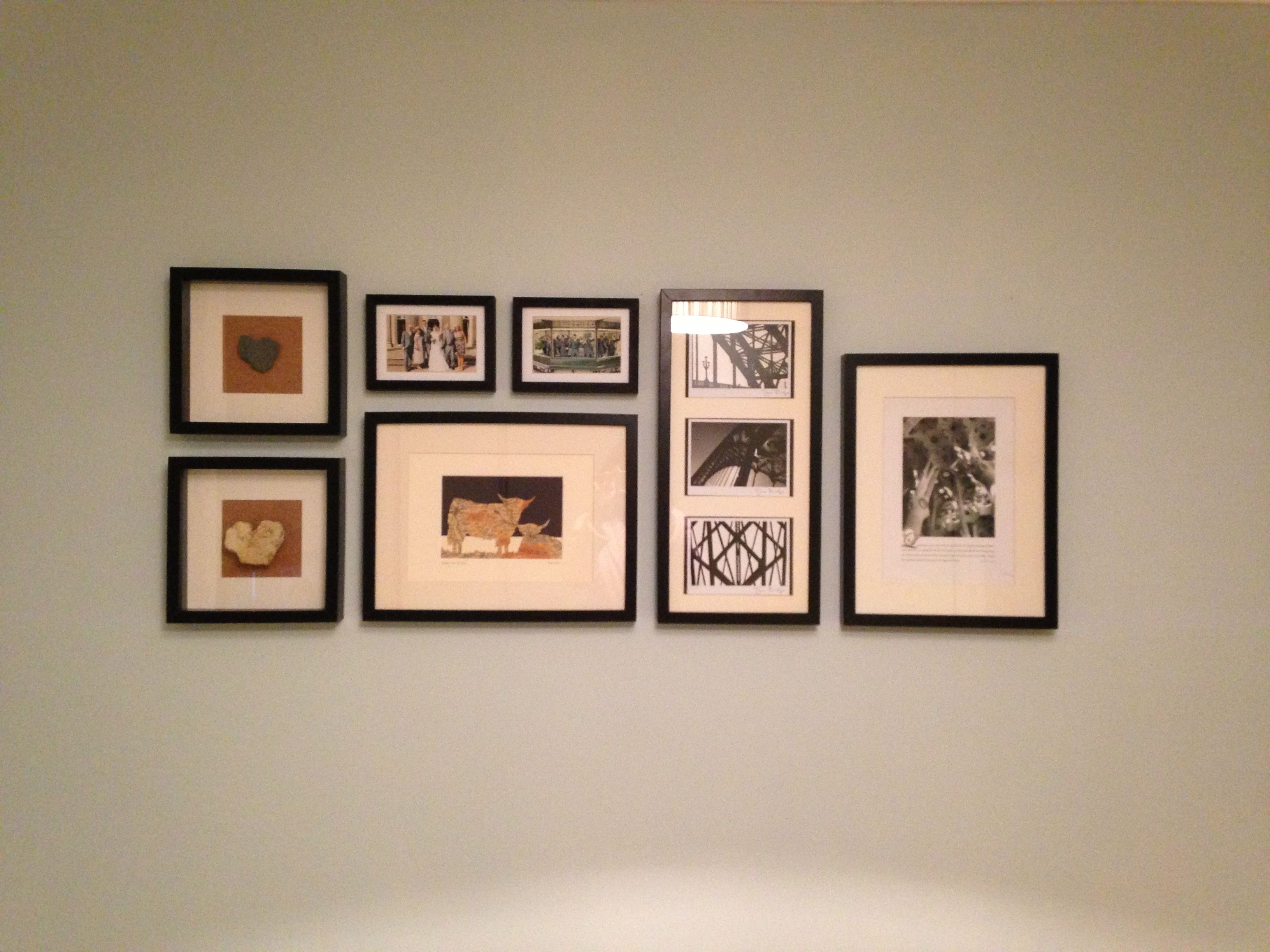 Photo Arrangement In Lounge Black Frames On Duck Egg Wall