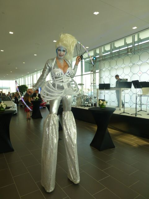 One of our silver and white stilt girls with her LED props- great for corporate events!! www.jdententertain.com