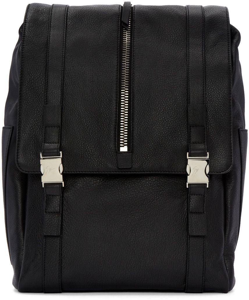Grained leather backpack in black. Carry handle at top. Adjustable shoulder straps. Patch pocket at sides. Foldover flap featuring zippered compartment and twin fixture straps at main compartment. Patch pocket and leather patch at bag interior. Textile lining. Silver-tone hardware. Tonal stitching. Approx. 13