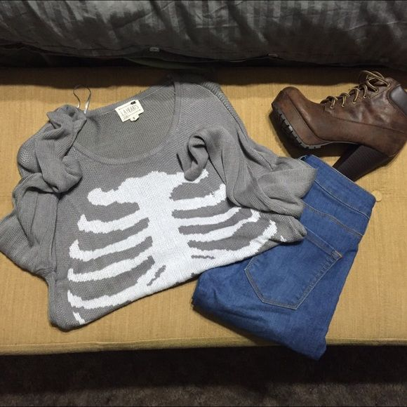 Long Sleeve Top Rib cage graphic top. It has a small hole as pictured above. I negotiate through the Offer Function LA Hearts Tops Tees - Long Sleeve