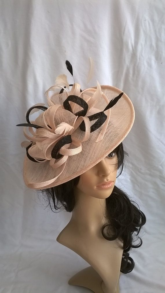 This is a pretty Shaped saucer Disc Fascinator in Nude (Biege tones) with  Black Trim (picture 2 is the nude pink tone) Doubled loops   17f6836ec8c