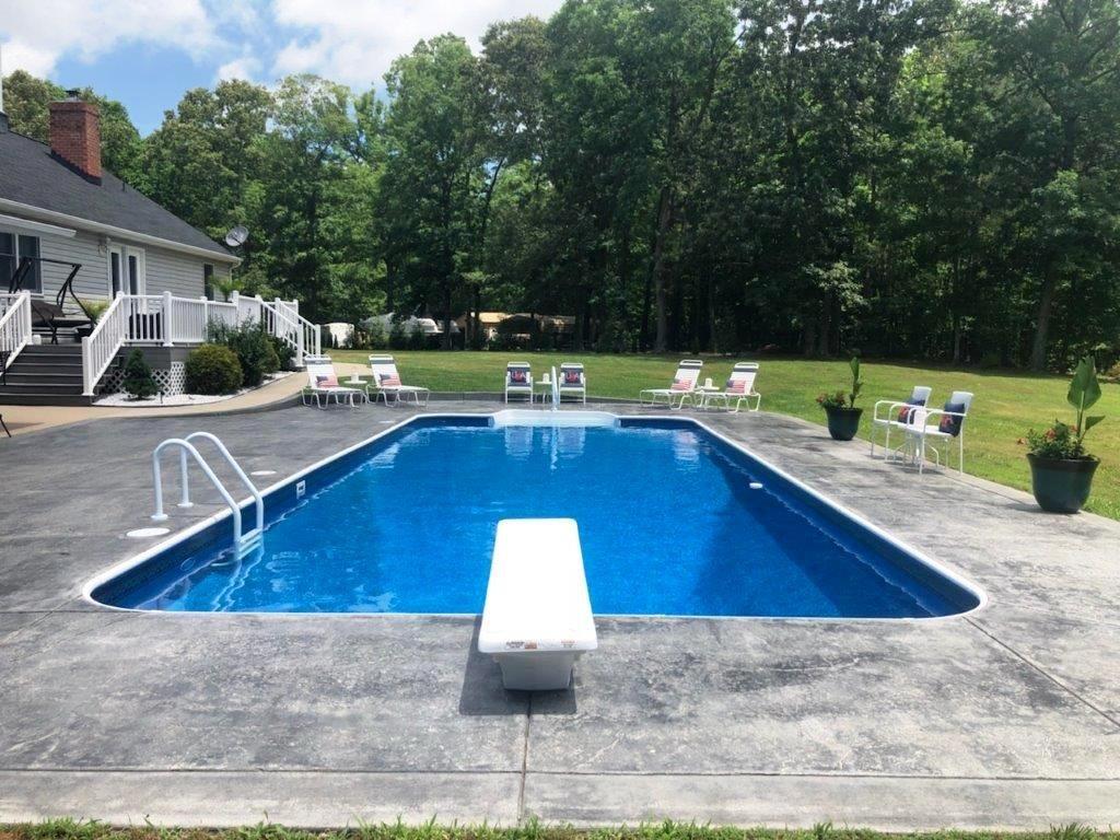 A Rectangle Pool With Radius Corners White Fiberglass Stairs In